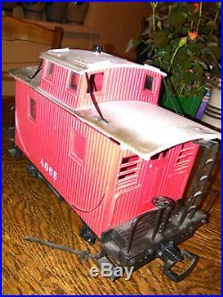 Locomotive à vapeur+ 3 wagons+circuit complet de rails+transfo
